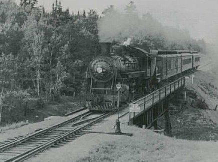 train on French River bridge
